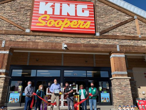 Ribbon Cutting Ceremony outside evergreen store